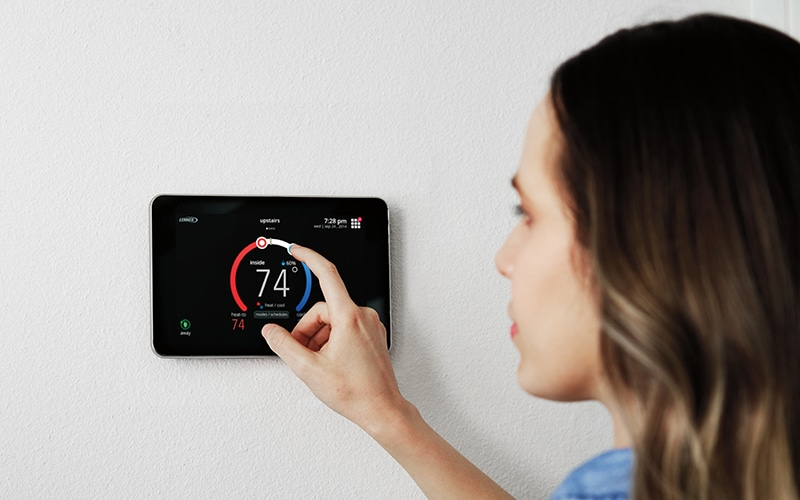 A women changing home temperature